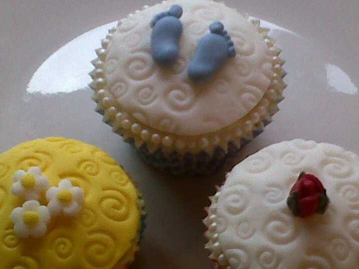 Celebration cupcakes decorated with fondant icing over buttercream