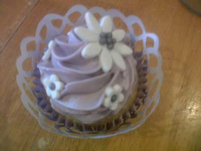 Wedding day cupcake decorated with luxury buttercream and fondant flowers