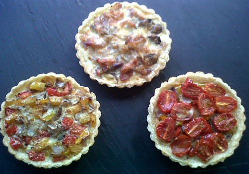 Buffet with quiche lorraine and mediterranean vegetable tartlets