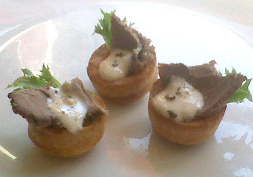 Mini Yorkshire puddings with roast beef and horseradish cream from our buffet menu